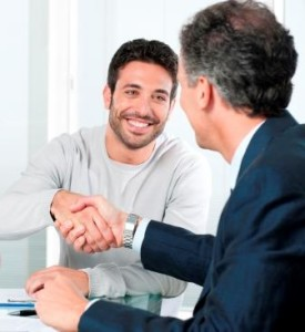 Job candidate getting offer shaking hands in interview